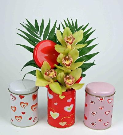 Voorraad blik hartjes met 4 orchideeën